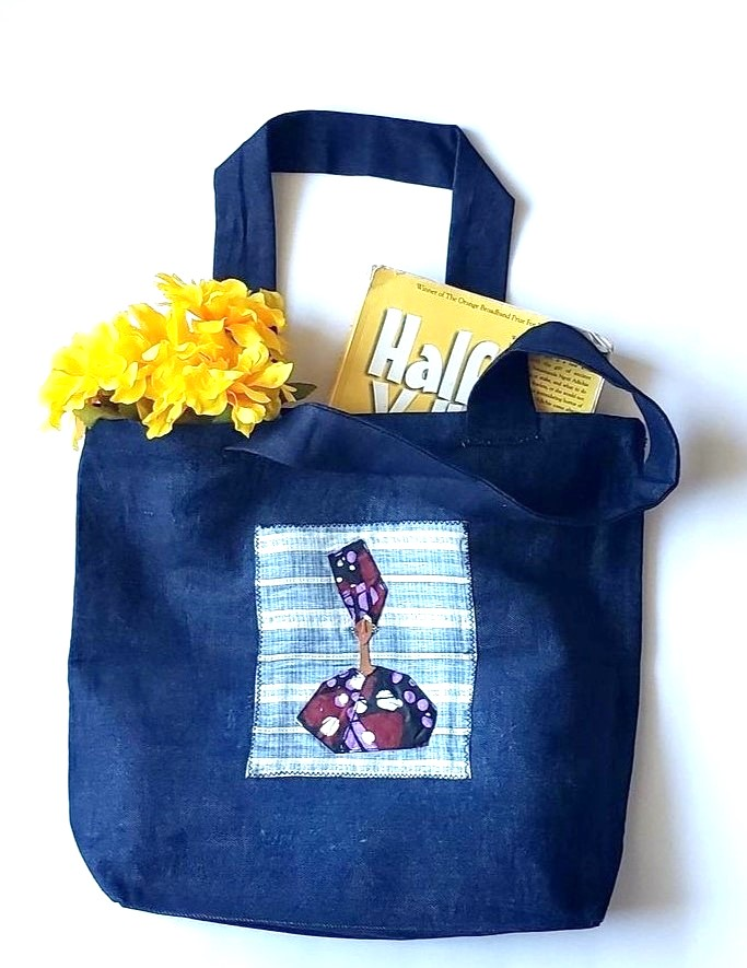 Tote, trim, applique African Lady staged